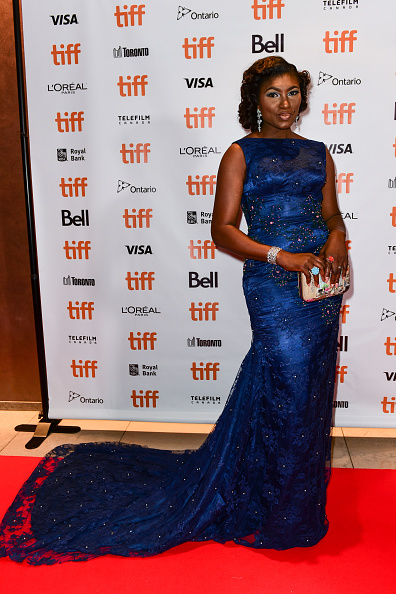 Ufuoma McDermott is simply gorgeous in this backless blue dress. (Image via Getty)