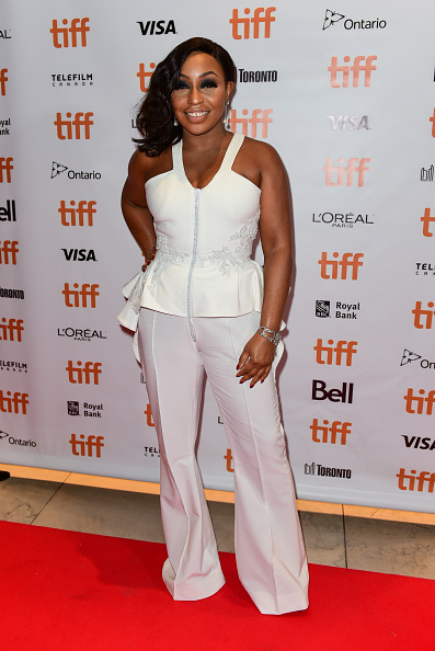 Angel Rita stuns in a white jumpsuit. We like! (Image via Getty)
