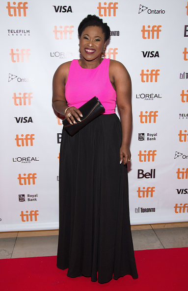 Uche Jombo looking fine in this pink and black maxi dress. (Image via Getty)